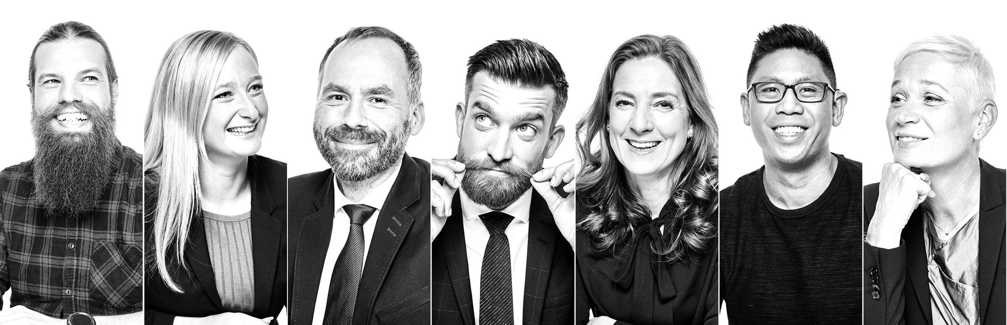 Seven of our employees in black and white portraits and authentic poses